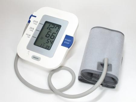 blood pressure monitor. Image used on dental blog to represent how flossing teeth can lower blood pressure.