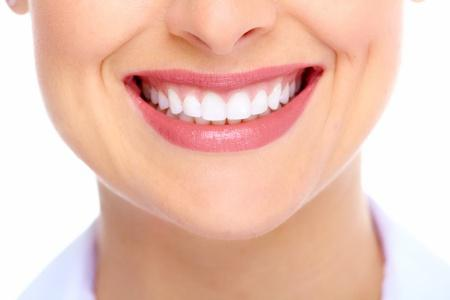 Woman smiling with very white beautiful teeth. No stains.